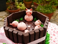 Repostería, Cómo preparar una tarta Kit Kat con cerditos